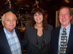 Manorhaven Mayor Jim Arena and Village Clerk Sharon Abramski with Baxter Estates Deputy Mayor Charles Comer