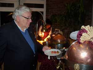 East Hills Mayor Michael Koblenz makes his selections from the holiday buffet
