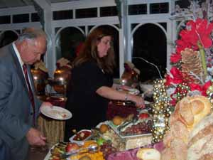 North Hills Deputy Mayor Dennis Sgambati and Plandome Heights Village Clerk Arlene Drucker enjoy the holiday buffet