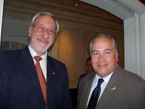 NCVOA Executive Director Ralph Kreitzman with Mineola Village Clerk Joe Scalero