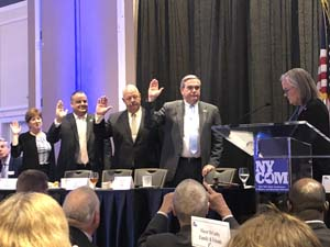 president ncvoa bob kennedy2nd l is shown being sworn in as the ny state conference of mayors 1st vice president